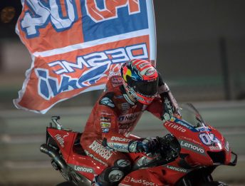 DOHA, QATAR - MARCH 10: Andrea Dovizioso of Italy and Ducati Team celebrates with flag the victory at the end of the MotoGP race during the MotoGP of Qatar - Race at Losail Circuit on March 10, 2019 in Doha, Qatar. (Photo by Mirco Lazzari gp/Getty Images)